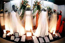 A row of pristine white wedding gowns by Edd Sy