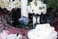 White flowers accentuate one of Mandarin  Oriental Manila's reception set-ups