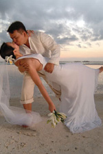 Beach Wedding by ImageNation Photography