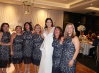 six women wore the same dress to a wedding