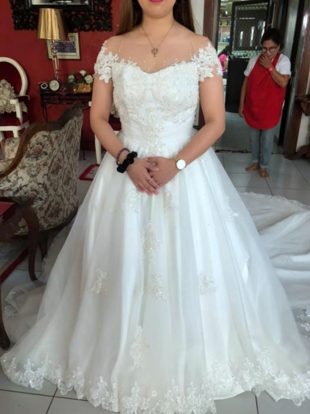 Wedding dress by New Creation Fashion By Evelyn G. Guerrero